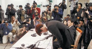 South Korea's Olympic swimming champion Park Tae-hwan bows during a news conference at a hotel in Seoul