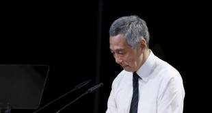 Singapore's Prime Minister Lee pauses as he delivers an address at the funeral of his father and Singapore's former leader Lee Kuan Yew at the National University of Singapore