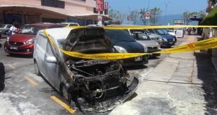 停泊车位上神秘失火的威华,引擎处被烧燬情景。